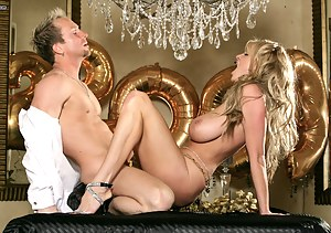 Kelly fucks her husband on the dinning room table to ring in the New Year.